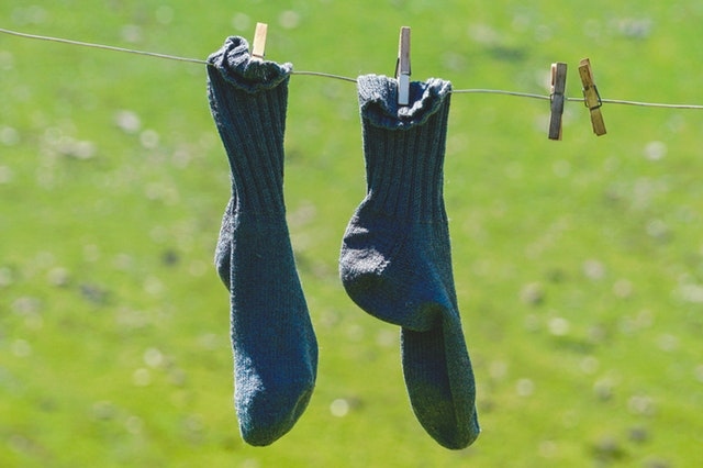 pair of socks on clothesline